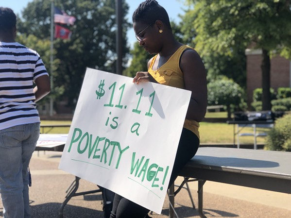 Students demand living wage for all campus workers at a fall protest. - MAYA SMITH