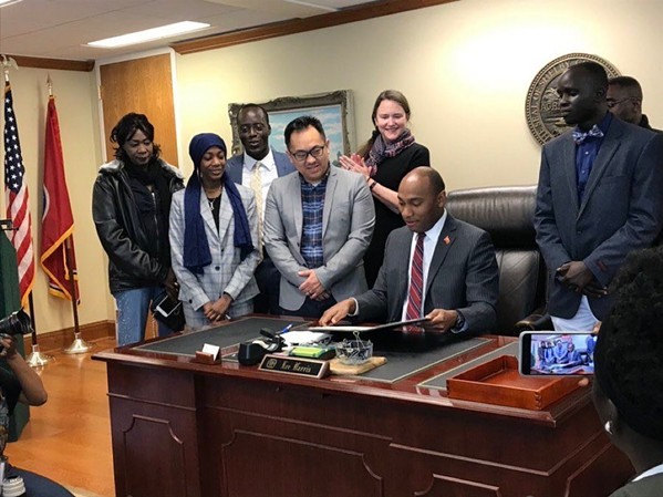 Mayor Harris signs letter consenting to refugee resettlement earlier this month - TIRRC