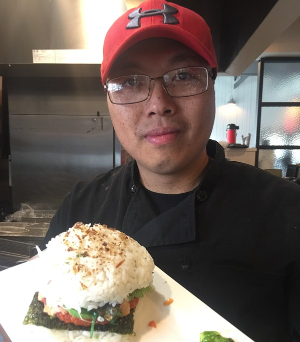 "Jimmy ""Sushi Jimmi"" Sinh and his ""Sushi Burger"" at Saltwater Crab. - MICHAEL DONAHUE"
