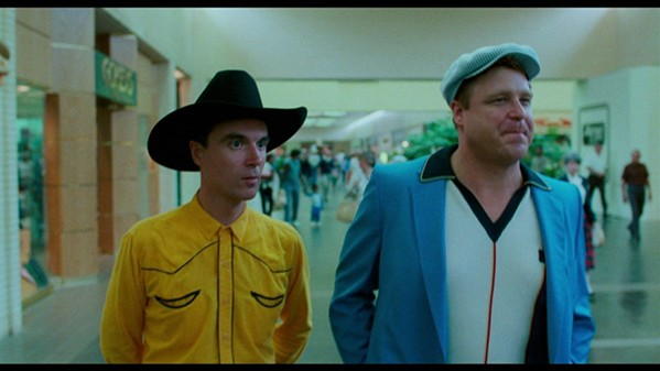 David Byrne and John Goodman hit the mall in True Stories.