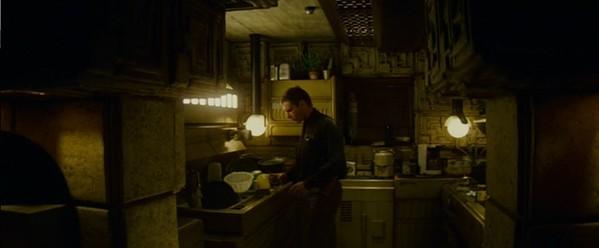 Harrison Ford as Rick Deckard, making dinner in his kitchen.
