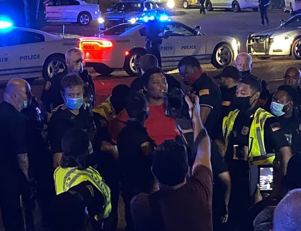 Police surround and arrest a protester - FACEBOOK/TAMI SAWYER