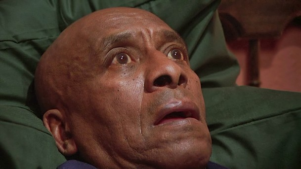 Mr. Hallorann (Scatman Crothers) recieves a psychic message.