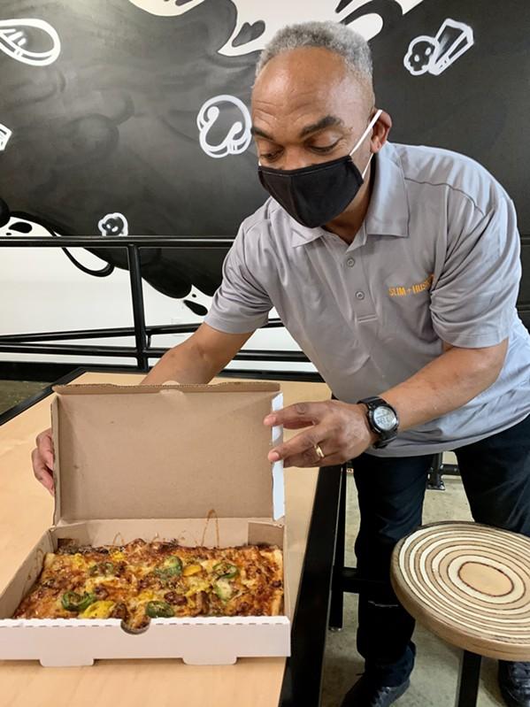 Slim and Husky's staff presents Nashville Hot pizza - CHRISTEN HILL