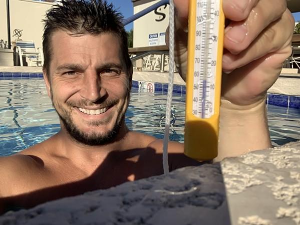 Brad Giesinger taking a chilly dip in his swimming pool. - MACI GIESINGER