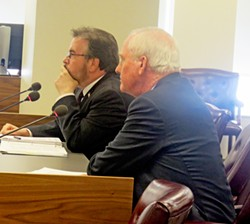 Attorney Koratsky and CAO Kennedy try to hold their own against Commission fusillade. - JB