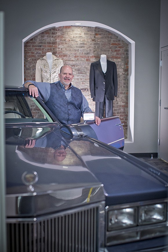 John Doyle, Executive director of the Memphis Music Hall of Fame, shows off a few of the museum's treasures including Jerry Lee Lewis' Cadillac, Johnny Cash's black suit, and an original Elvis jumpsuit. - JUSTIN FOX BURKS
