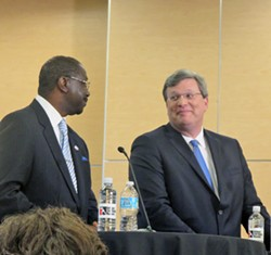 Though they exchanged cordial glances early on, mayoral candidates Harold collins (left) and Jim Strickland played independent hands Monday night. - JB
