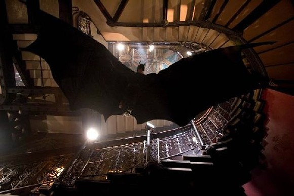 Christian Bale as Batman drops in.
