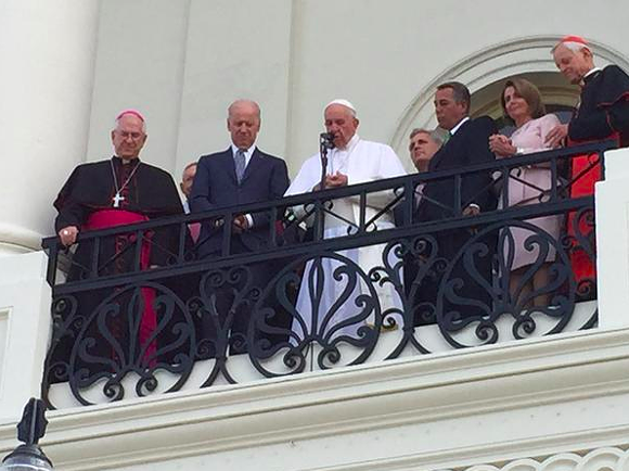 Vice President Joe Biden, Congressional leaders, and religious leaders pray with Pope Francis on the U.S. Capitol's west balcony. - STEVE COHEN