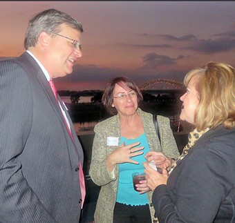 Mayoral candidate Jim Streickland greets well-wishers Deni Hirsch and Cindy Tucker at a Tuesday night fundraiser on a Front St. rooftop. - JB