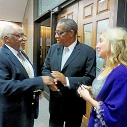 Julian Bolton (center) is congrartulated by Coby Smith (l) and Commissioner Heidi Shafer after a veto-override vote cleared his way toward appointment as County Commission attorney. - JB