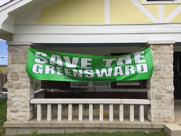 A 'Save the Greensward' banner hangs on Southern Growth Studio on Sam Cooper. - GET OFF OUR LAWN