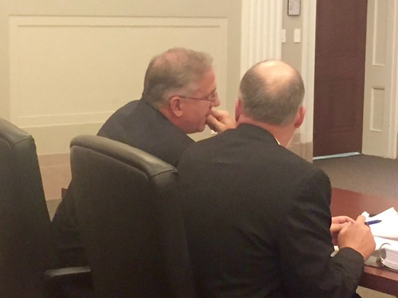 Stephen Jones (left) confers with his attorney Brian Faughnan (right) during Thursday's hearing. - TOBY SELLS