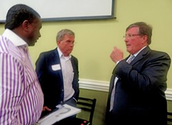Rep. Craig Fitzhugh (D-Ripley), at Wednesday's TNA forum, talks things over with District 96 House candidate Dwayne Thompson (center) and Thompson campaign adviser Bret Thompson. - JB