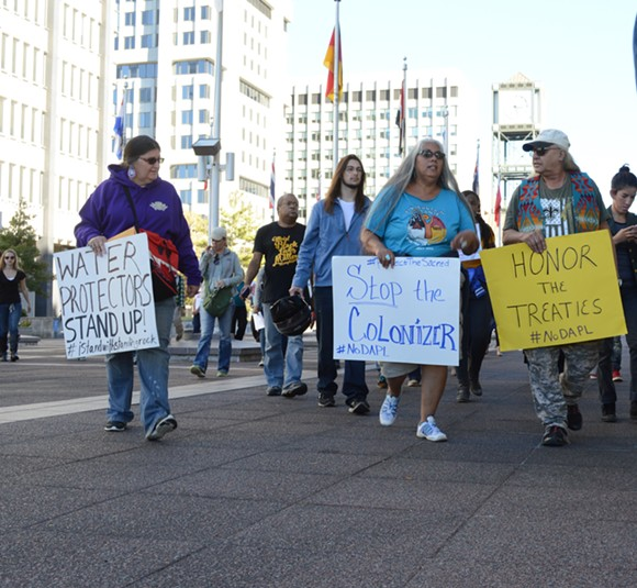 More than 50 people protesting the Dakota Access Pipeline peacefully marched to the front of the Clifford Davis Odell Horton Federal Building in Downtown Memphis and were denied access to the U.S. Army Corps of Engineers with no explanation given. - MICAELA WATTS