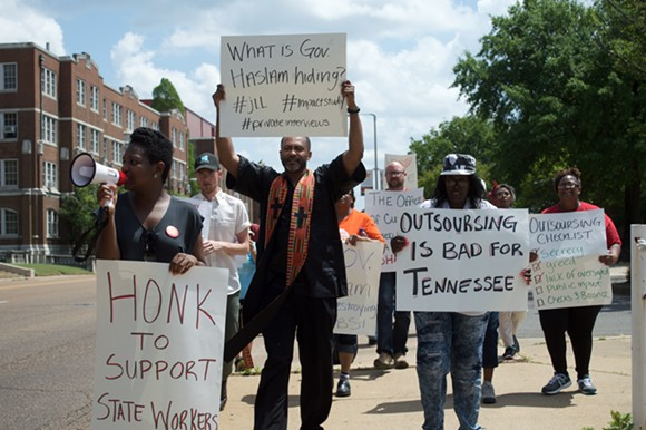 On April 19, campus workers and union representatives waited outside of the University of Tennessee Health Science Center to confront Terry Cowles, who was meeting with university officials to discuss details of the proposed outsourcing. - MICAELA WATTS