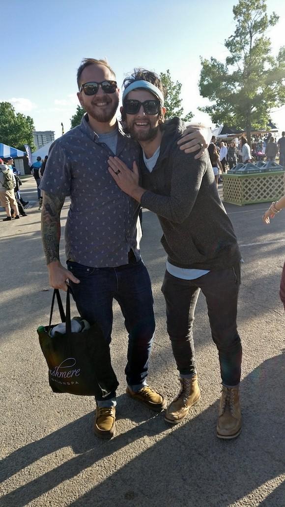 Nashville visitors Andrew Gonzalez and Drew Thomas hug it out. - E. J. FRIEDMAN