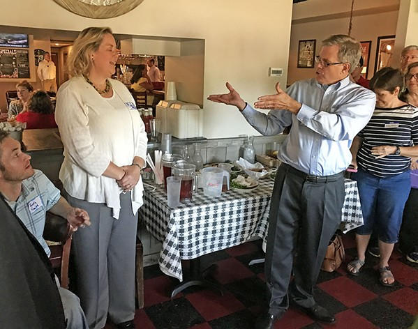 Rep. Dwayne Thompson (r), the Democrats' surprise winner in last fall's race in state House District 96, hopes to transfer his magic to District 95 Democratic candidate Julie Byrd Ashworth, seen here at recent fundraiser in Germantown. - JB