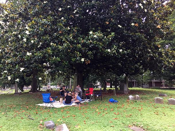 A party of picnickers beneath the magnolias at Elmwood Cemetery - SUSAN ELLIS