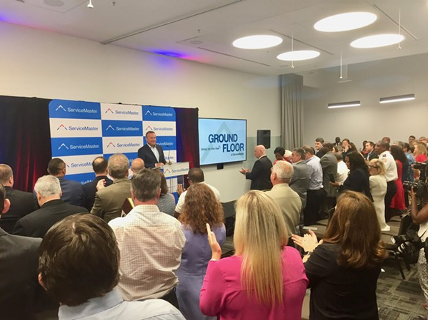 """ServiceMaster CEO Rob Gillette gets a warm welcome during the grand opening of the """"Ground Floor"""" on Thursday."""