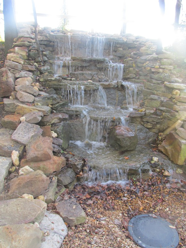 A waterfall adds to the rural ambience of Carolina Watershed - MICHAEL DONAHUE