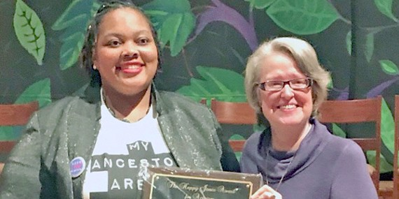 "Tami Sawyer receives ""Happy Jones Award"" from Paula Casey at Mid-South Peace and Justice Center."