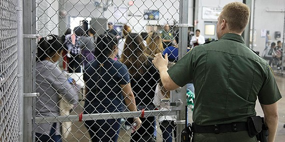 Children line up inside a U.S. immigration detention center.