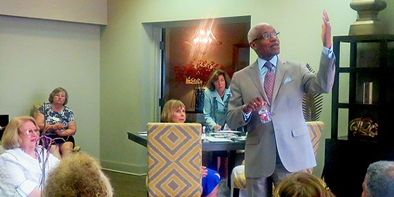 Mayor A C Wharton talks to the hand and to members of Women for Wharton at Waterford Plaza