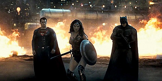 Henry Cavill (left) and Ben Affleck challenge each other to a duel of grimaces in Snyder's Frank Miller-inspired superhero smash-up.