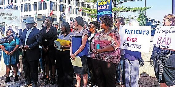 Local Democrats at health-bill protest