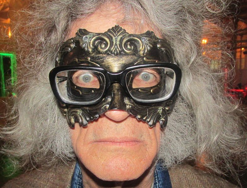 Guests - and a reporter - donned masks at the Military Masquerade. - LACEY HUDMAN