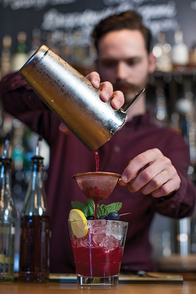 Get bartender Nick Lumpkin (opposite) to mix you something at the original Sweet Grass.