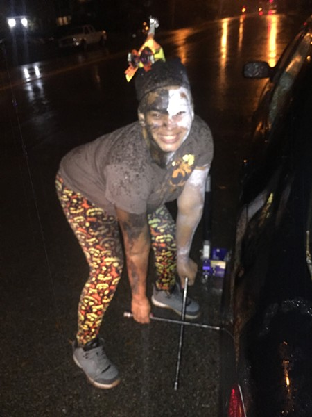 Mow Decher of Flash Roadside Service wore a Halloween costume while she worked on Oct. 31. - MICHAEL DONAHUE
