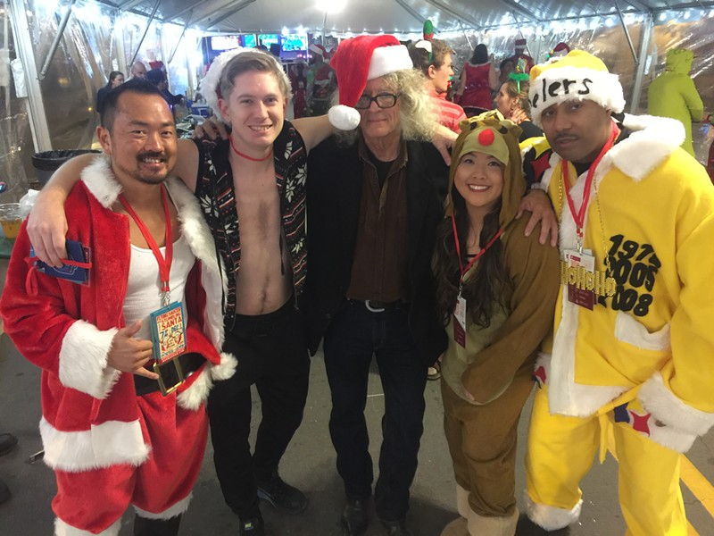 Santas and other holiday characters, including Rudolph the Red Nosed Reindeer and Donahue the Long-Haired Reporter, were at the Stumbling Santa Pub Crawl. - MICHAEL DONAHUE