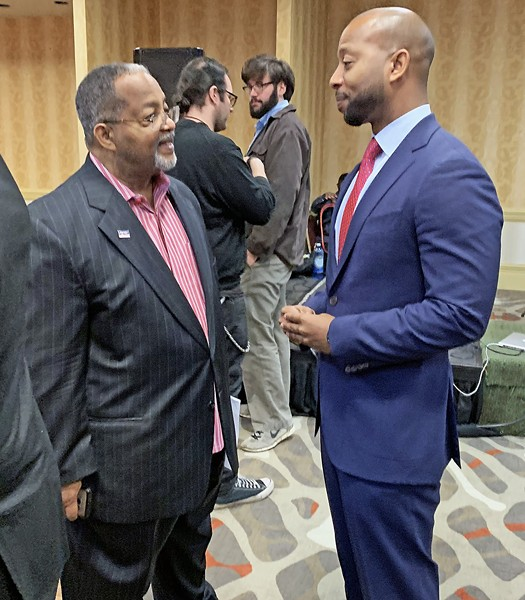 FATHER-SON COMBO: Once and possibly future  City Councilman Myron Lowery (l) with current County Commissioner Mickell Lowery, his son, at the Lowerys' annual New Year's prayer breakfast. - JB