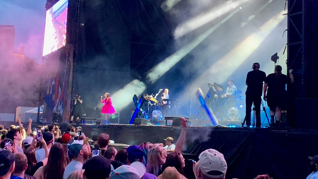 Chvrches' Lauren Mayberry is bathed in light as she whips up the crowd. - CHRIS MCCOY