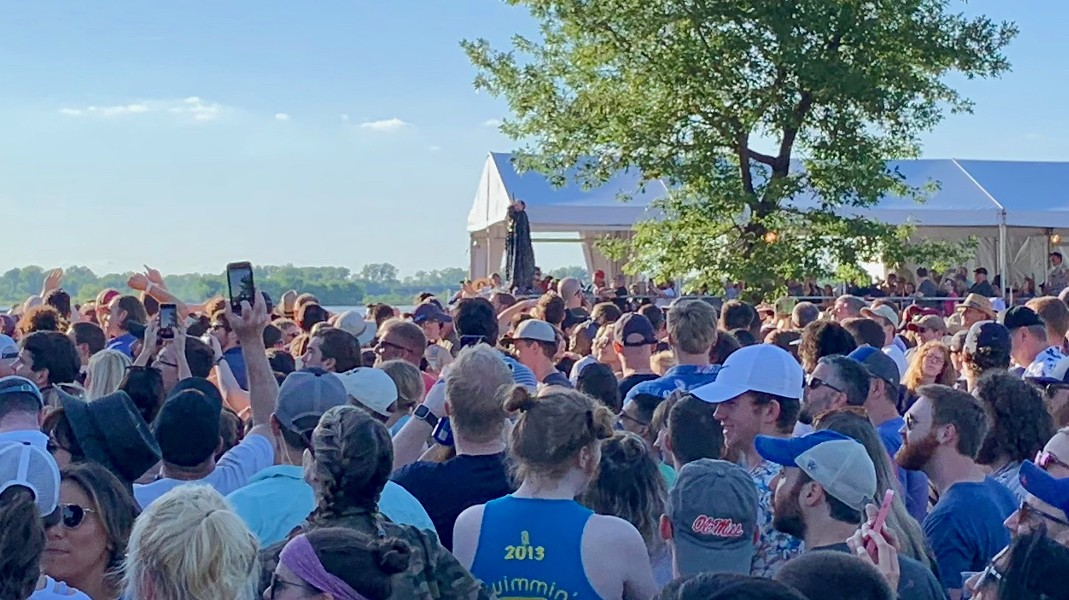 That's Paul Janeway of St. Paul and the Broken Bones hanging off the VIP tent. It would have looked a lot cooler if I had been closer. - CHRIS MCCOY