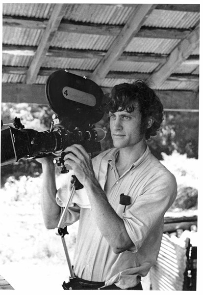 Dr. William Ferris with his camera in Mississippi in the 1970s.