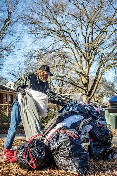 """Robert Holden, who is currently experiencing homelessness, very generously allowed himself to be photographed as he looked through a """"picker pile"""" — the de facto symbol of Memphis' eviction crisis. - PHOTOGRAPHS BY JUSTIN FOX BURKS"""