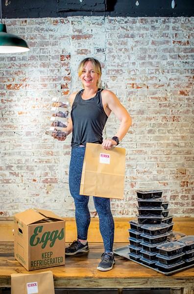 Brandi Marter serves food up old-school at Bedrock Eats. - JUSTIN FOX BURKS