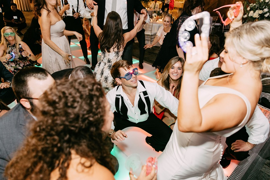 Alex Solomito gets down - literally - on the Raiford's style dance floor at his and Lauren Solomito's (standing) wedding reception. - KELLY GINN PHOTOGRAPHY