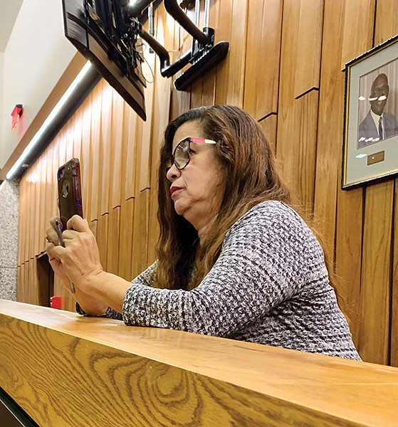 Erika Sugarmon, an advocate - for voter-marked ballots, shooting video of county commission debate on concept - JACKSON BAKER