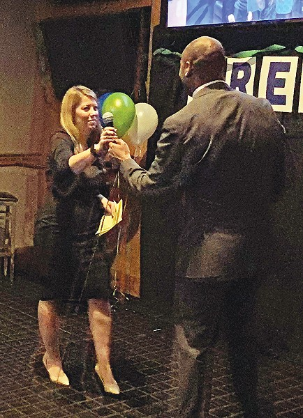 Accepting the mic (and an endorsement) from County Mayor Harris, Jerri Green addresses Democrats in East Memphis. - JACKSON BAKER