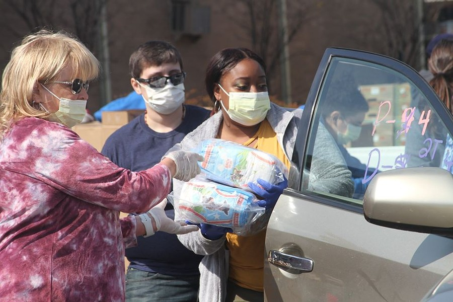 Volunteers load food into a car at a mobile food pantry - FACEBOOK/MID-SOUTH FOOD BANK