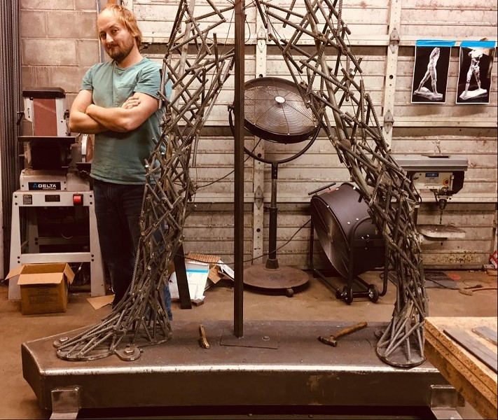 Elisha Gold with his Rodin-inspired sculpture.