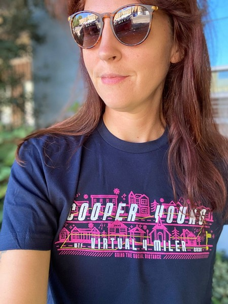 The 2020 Cooper-Young Festival Four Miler is modeled in a Facebook photo by CYCA executive director Amanda Yarbro-Dill. The shirts are available even if you don't run the race. - COOPER-YOUNG FESTIVAL FOUR MILER