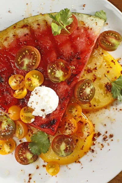 Grilled watermelon salad with goat cheese, tomatoes, and honey-lime vinaigrette - JUSTIN FOX BURKS