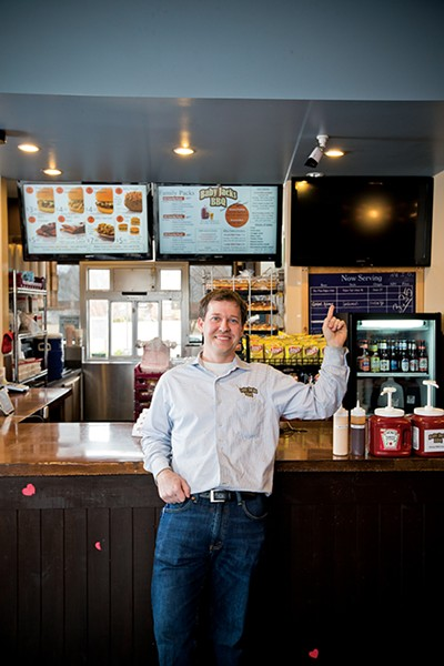 Will Clem points to the new blank menu at Baby Jack's, where prototype products may be featured. - JUSTIN FOX BURKS