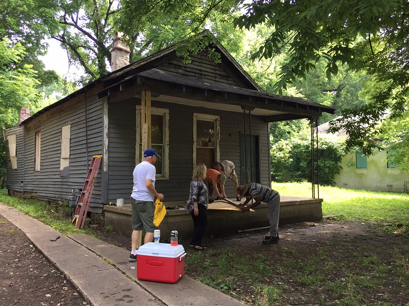Memphis Heritage volunteers attempt to secure Aretha Franklin's birthplace home. - BIANCA PHILLIPS